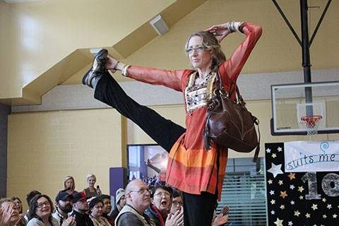 Spectrum clinic peer support worker Bronwen Sims incorporates yoga into her modelling for the 10th annual Suits Me Fine fashion showinto her modelling for the 10th annual Suits Me Fine fashion show